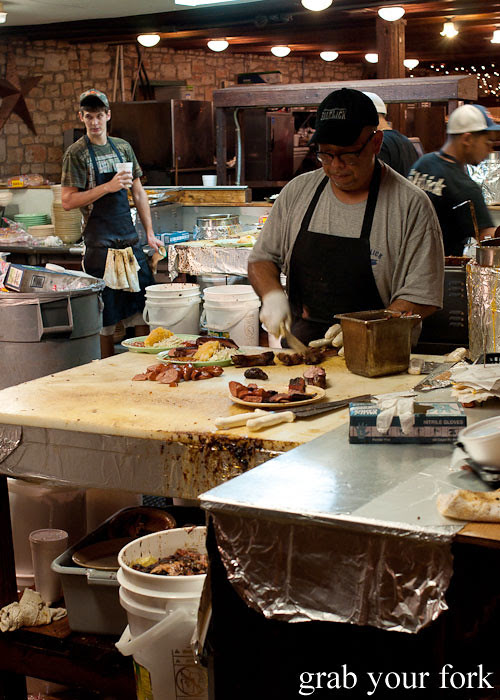 chefs in the open kitchen at the salt lick bbq driftwood austin texas