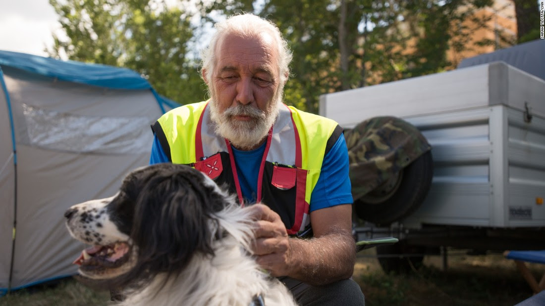 Arturo Filippi pets rescue dog Sam Sam at a volunteer camp in Amatrice. Fillipi, who lives in Venice, is a logistics coordinator with 16 years experience in disaster response, including this earthquake and two others.