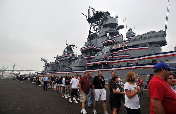 A long line forms as people wait to board the USS Iowa at San Pedro's Berth 87 on July 7, 2012.