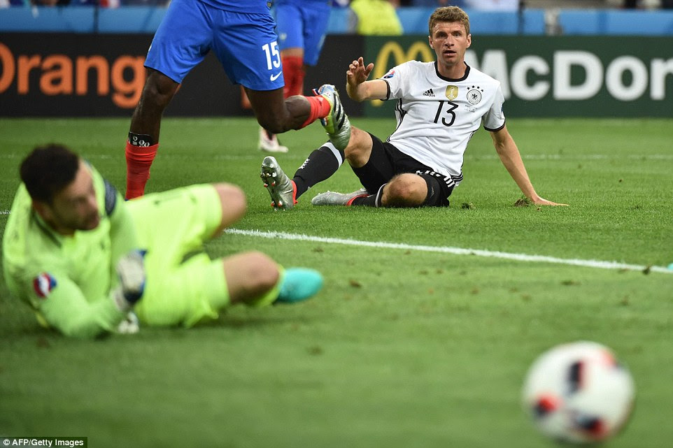 Thomas Muller's frustrating tournament continued in the first period as he dragged a good chance wide of Lloris' goal
