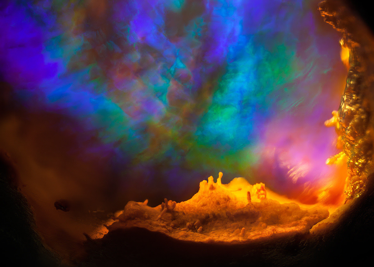 Opal in rhyolite looks like the birth of a galaxy