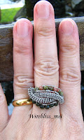 wire wrap ethnic ring on finger