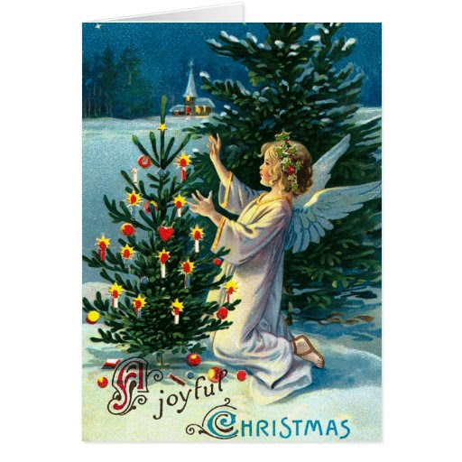 Angel Decorating Christmas Tree 2 Greeting Cards from Zazzle.