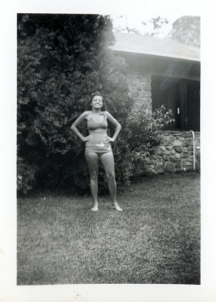 Hollie in bathing suit standing in front yard