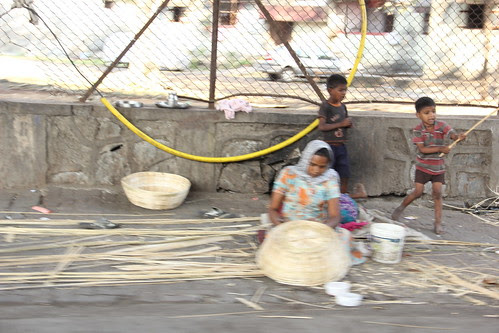 weaving a tale of survival through the meshes of a basket by firoze shakir photographerno1