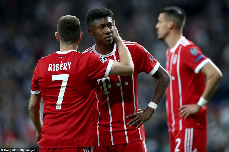 Franck Ribery of Bayern Munich comforts team-mate David Alaba following their narrow defeat by Real Madrid