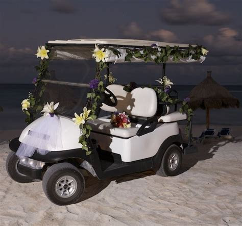 Cool! Decorated golf cart to get you to your beach wedding