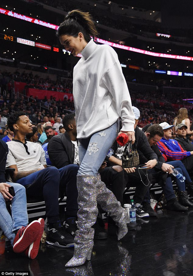 Oh my! The TV reality star added a glamorous flare with kinky knee-high boots covered in crystals, retailing at an eye-watering $10,000 at designer fashion house Saint Laurent
