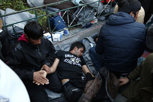 The men, one of whom was unconscious, were rushed to hospital from the square, a common destination for migrants when they reach Athensfrom the Aegean Sea islands