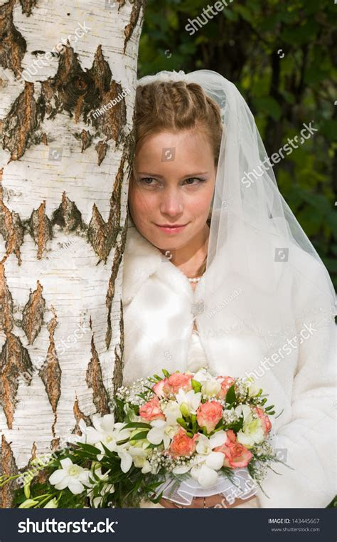 Happy Young Bride Posing After Wedding Stock Photo