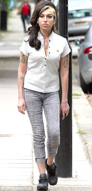 Healthy: Amy was spotted out in London looking healthier earlier this month
