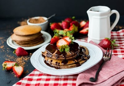Chocolate pancakes, strawberries and whipped cream