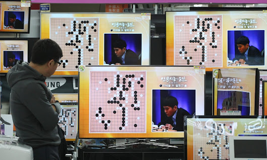 Google's AlphaGo AI defeats human in first game of Go contest