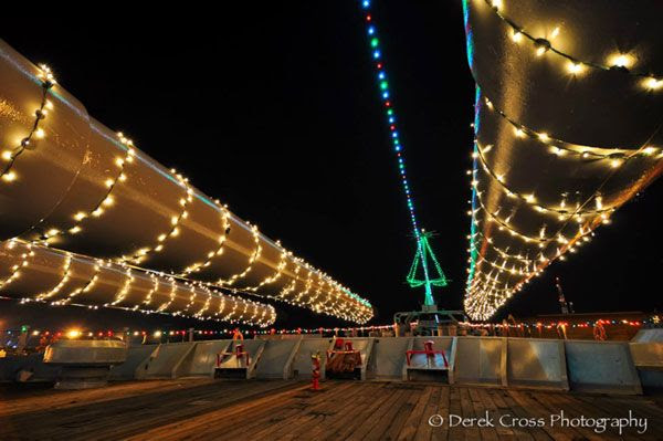 Three of the USS Iowa's forward 16-inch guns are adorned in Christmas lights.