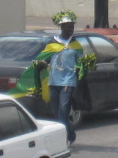 Man selling Jamaican Flag
