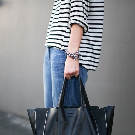 Le Fashion Blog Blogger Style Slouchy Striped Tshirt Silver Chain Bracelets Large Leather Tote Bag Boyfriend Jeans Via Modern Legacy