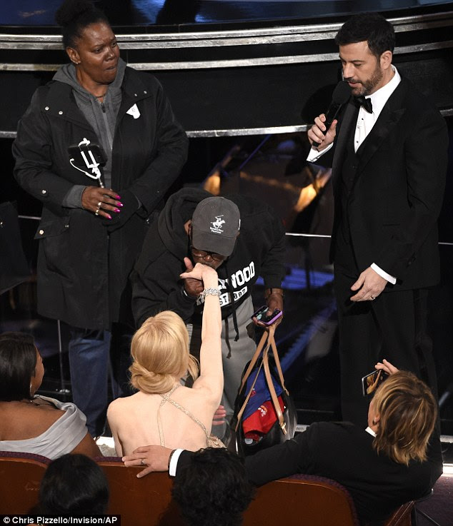 Kiss: As he was introduced to the Oscars ceremony, Gary Coe reached out and kissed Nicole Kidman's hand