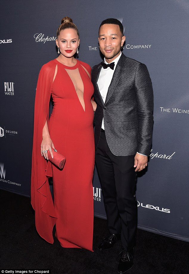Red hot:Chrissy Teigen sizzled as she and husband John Legend headed to the Weinstein Company's Pre-Oscar Dinner in Beverly Hills, california, on Saturday night