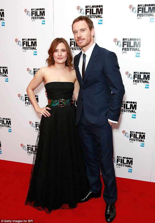Cosy co-stars: Michael wrapped an arm aroundLyndsey Marshal's waist at the premiere