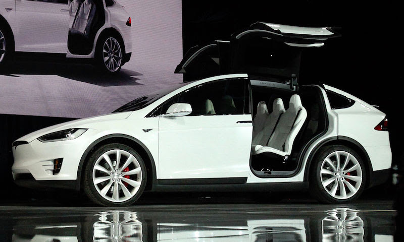 """Tesla Model X. By <a href=""""//commons.wikimedia.org/wiki/File:Tesla_Model_X_vin0002.jpg"""" title=""""File:Tesla Model X vin0002.jpg"""">Tesla Model X vin0002.jpg</a>: Steve Jurvetsonderivative work: <a href=""""//commons.wikimedia.org/wiki/User:Mariordo"""" title=""""User:Mariordo"""">Mariordo</a> - This file was derived from <a href=""""//commons.wikimedia.org/wiki/File:Tesla_Model_X_vin0002.jpg"""" title=""""File:Tesla Model X vin0002.jpg"""">Tesla Model X vin0002.jpg</a>:<a href=""""//commons.wikimedia.org/wiki/File:Tesla_Model_X_vin0002.jpg"""" class=""""image""""></a>, <a href=""""http://creativecommons.org/licenses/by/2.0"""" title=""""Creative Commons Attribution 2.0"""">CC BY 2.0</a>, https://commons.wikimedia.org/w/index.php?curid=44050985"""