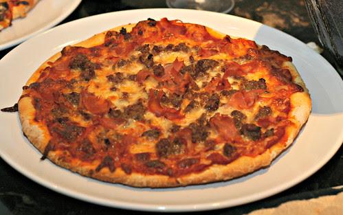 prosciutto and sausage pizza