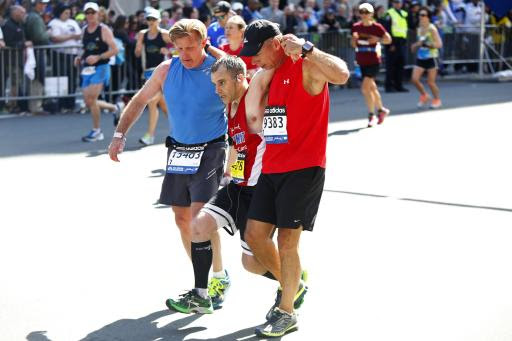 The story behind that Boston Marathon photo of runners carrying a competitor toward the finish