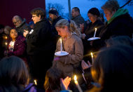 Megan Lehman, center, stands amongst a crowd of over 50 people who gathered Monday night, Dec. 26, 2011, for a candlelight vigil for missing 9-year-old girl Aliahna Lemmon, in Fort Wayne, Ind. Lemmon was last seen Friday, Dec. 23. (AP Photo/The Journal Gazette, Swikar Patel) NEWS-SENTINEL OUT