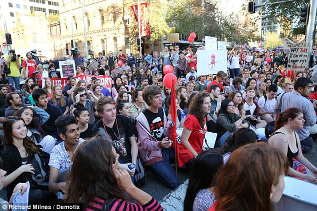 Unruly mob: Sydney's George street was overflowing with placard-carrying youths
