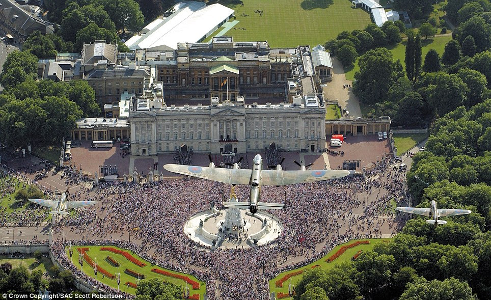 Royal seal: The traditional Battle of Britain Memorial Flight formation of the Lancaster, Spitfire and Hurricane approaches Buckingham Palace in July 2005