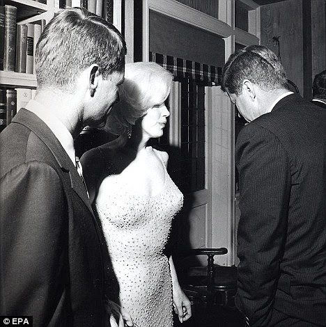 Chat: Monroe, wearing her famous dress, speaks with John F Kennedy following the rendition of Happy Birthday