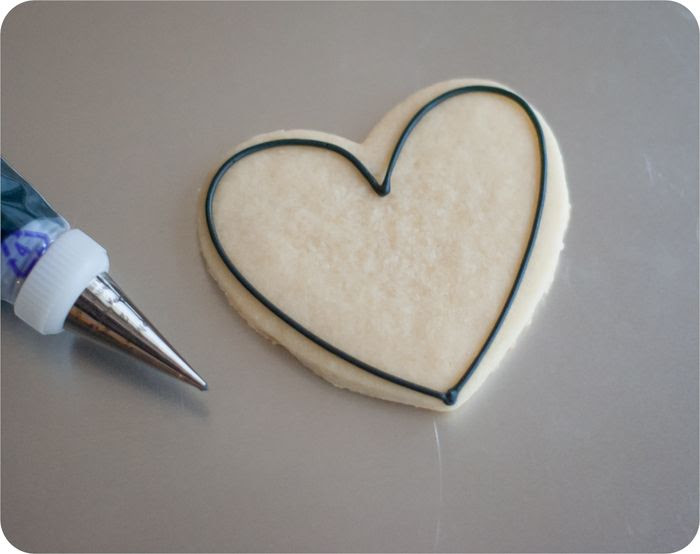 heart-shaped skunk cookies ... you're too stinkin' cute!  {valentine decorated cookie tutorial}