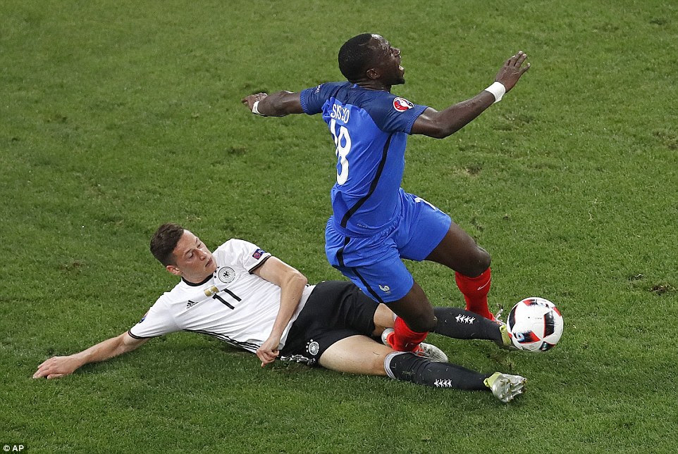 Draxler slides through the back of Moussa Sissoko, earning the German forward a yellow card early in the second period