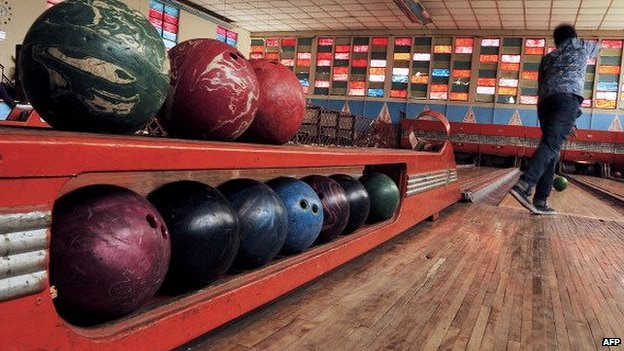 A man bowls in the Asmara bowling alley in Asmara, the capital of Eritrea, on 20 July 2013
