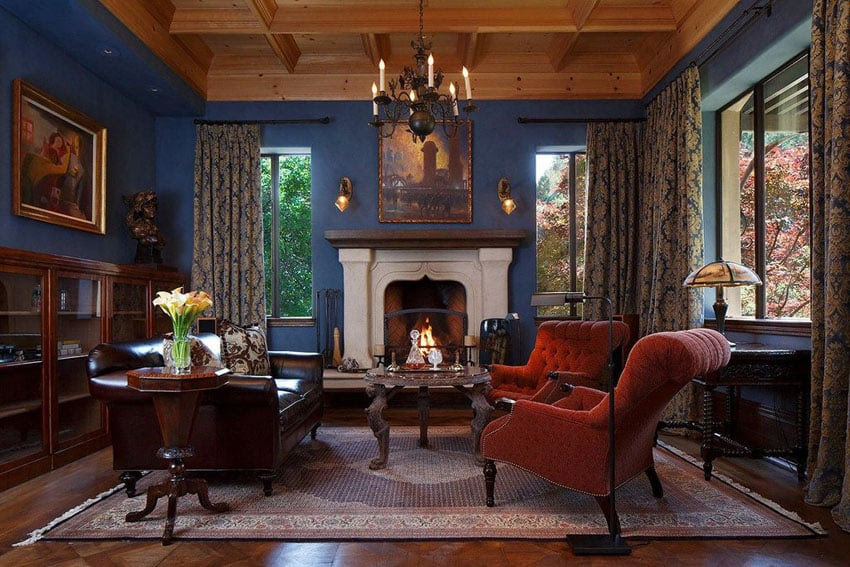 elegant living room with fireplace and blue walls with wood ceiling 16