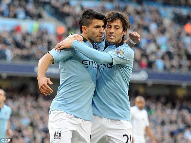 Celebration: Sergio Aguero (left) and David Silva mark the second goal