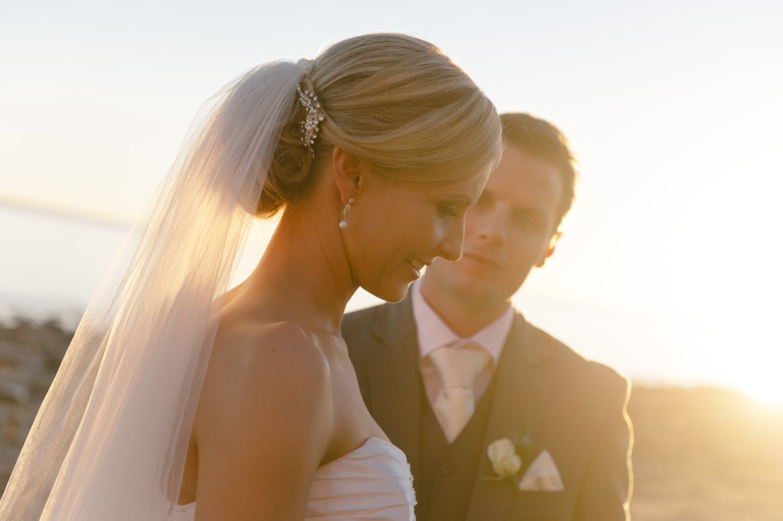 Sleek bridal  updo  low  chignon with rhinestone barret and