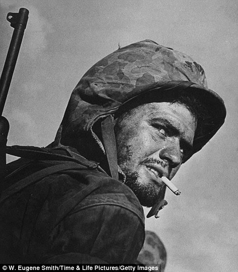 Grizzled, battle-weary, cigarette-smoking Marine PFC T. E.  Underwood on Saipan during the fight to wrest the island from Japanese troops, Saipan, Northern Mariana Islands, July 1944