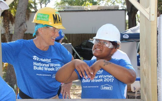Women flex their muscles at Habitat for Humanity build event