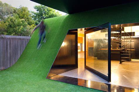 hill house  built  sunny living area   grassy