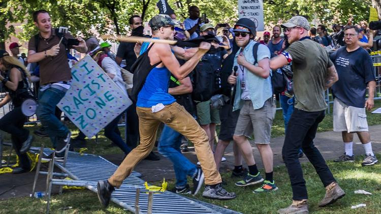 White supremacists and counter protesters clash in Charlottesville on Saturday.