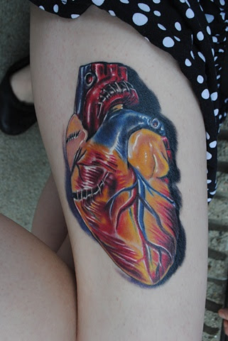 Awesome Colored Heart Tattoo On Thigh