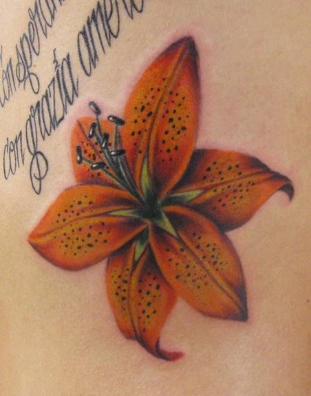 Beautiful Flower Tattoos Tiger Lily On The Ribs Tattoomagz