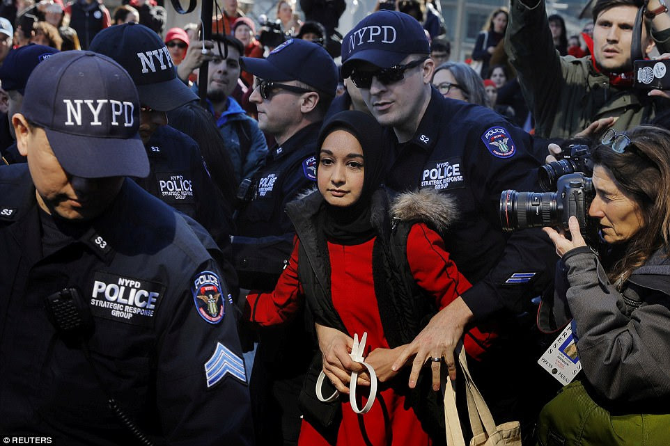 New York Police Department officers arrest a woman who was taking part in the 'Day Without a Woman' march on International Women's Day in New York on March 8. Organisers marketed the march as a day of economic solidarity standing for the justice and human rights of women and all gender-oppressed people