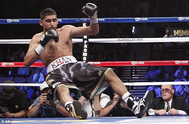 Down and out: Khan travels to the canvas in the decisive fourth round