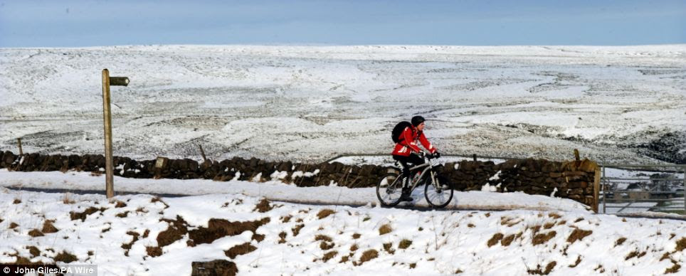 Cold snap: A cyclist braves the cold on the Pennine hill tops near Skipton, in the Yorkshire Dales