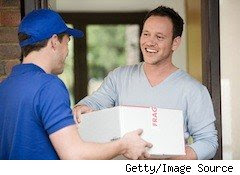 delivery man delivers a parcel to a happy guy