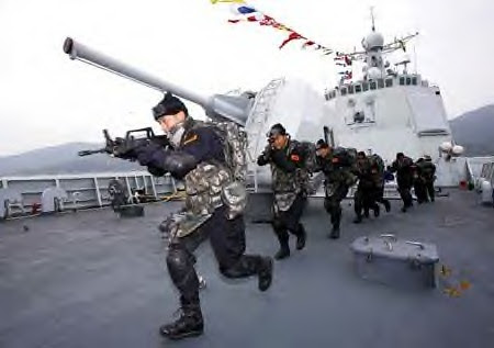 Soldiers of Chinese navy special force carry out an anti pirate drill on the deck of DDG-171 Haikou destroyer in Sanya, capital of South China's Hainan Province, on Dec. 25, 2008.(Xinhua Photo) by Pan-African News Wire File Photos