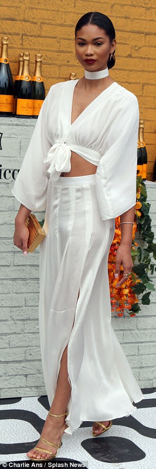 Flashing the flesh! Agdal's flirty shorts displayed her legs, while Chanel Iman bared her midriff in a slouchy white top