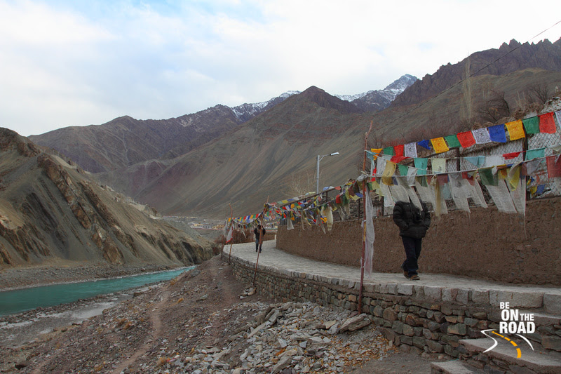 The Indus river flows behind the Alchi Monastery