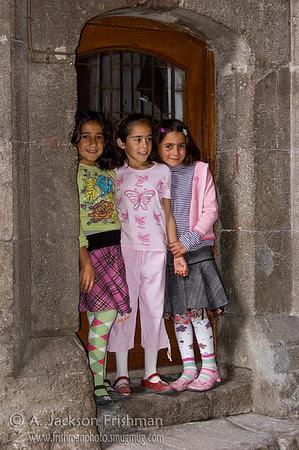 Three Turkish girls at the Çifte Minareli Medrese, Erzurum, Turkey.